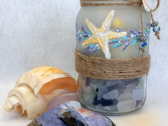 decorative painted mason jar with starfish and lavender garland and shells